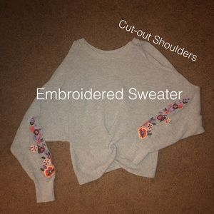 Embroidered sweater with cut out shoulders